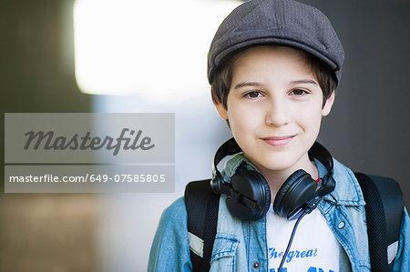 Portrait of boy wearing flat cap, close up