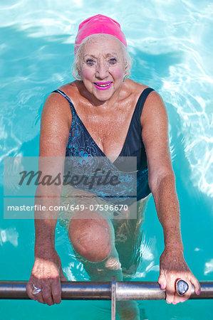 Portrait of happy senior woman in swimming pool