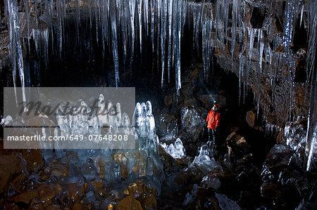 Mature woman exploring Buri cave, Threngsli, Iceland