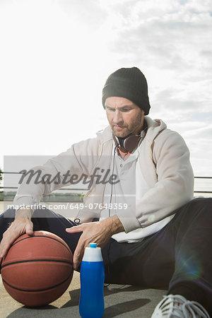 Basketball player on floor with basketball