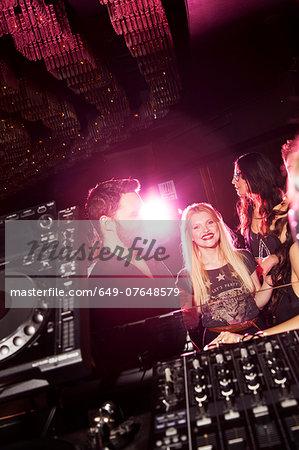 Young man and women flirting in nightclub