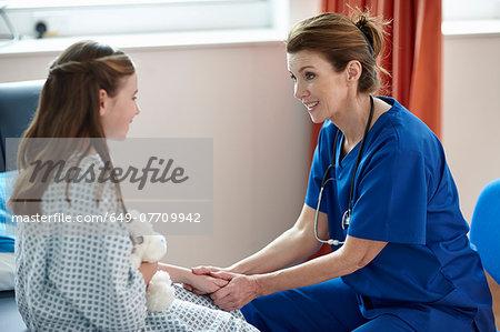 Nurse talking to girl