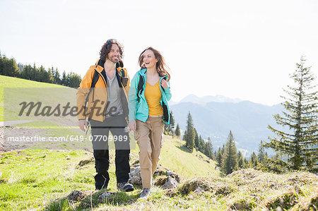 Mid adult couple walking through Tegernsee, Bavaria, Germany