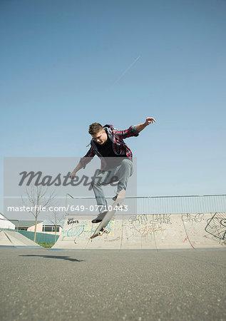 Young man doing skateboarding trick