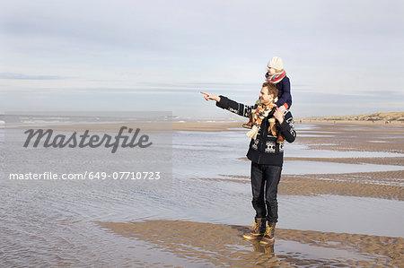 Mid adult man giving daughter shoulder ride on beach, Bloemendaal aan Zee, Netherlands
