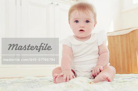 Portrait baby girl sitting on floor