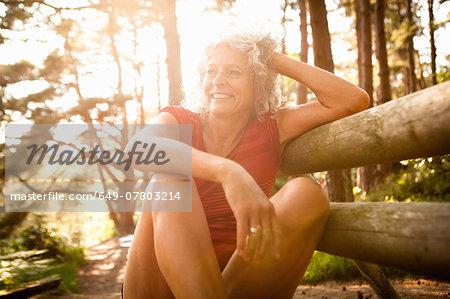 Woman enjoying nature, The Blue Pool, Wareham, Dorset, United Kingdom