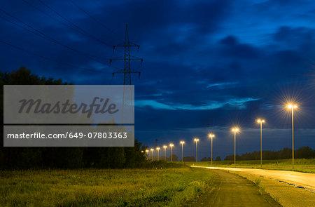 Empty road near Antwerp harbour at night , Antwerp, Belgium