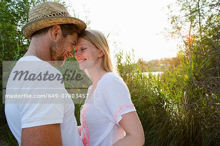 Romantic mid adult couple at lakeside