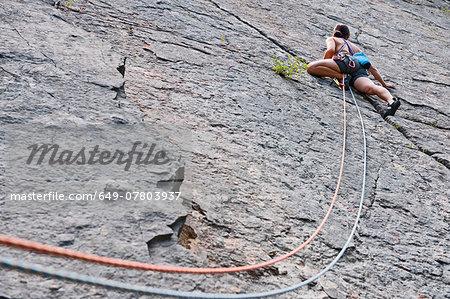 Female climber, lead climbing, Halfway to Kansas at Fairy Cave Quarry