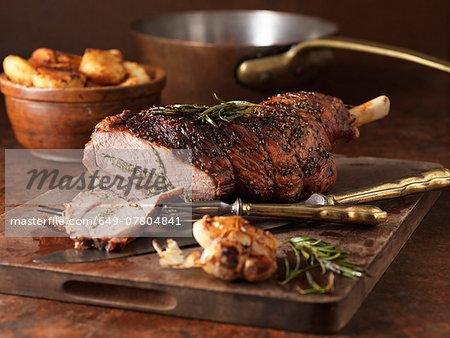 Christmas dinner. Roasted rosemary and garlic leg of lamb and roast potatoes