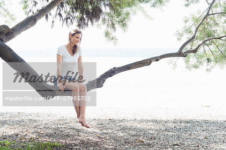 Woman relaxing on beach, Ammersee, Herrsching, Bavaria, Munich