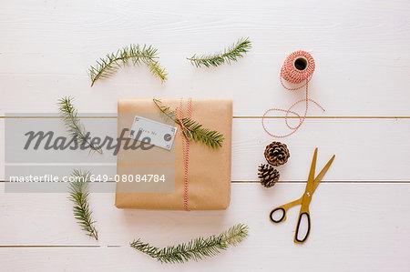 Christmas gift, thread, scissors, pine cone, pine needles
