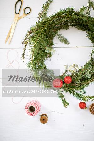 Christmas wreath, scissors, thread, baubles