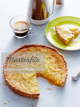 Still life of sliced Italian lemon tart