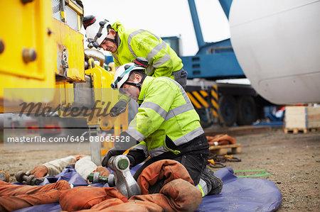 Engineers preparing to work on wind turbine