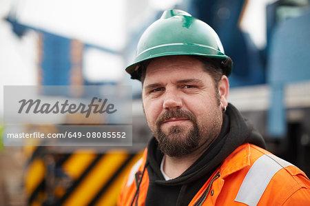 Portrait of engineer at wind farm