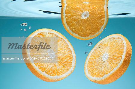Slices of orange underwater