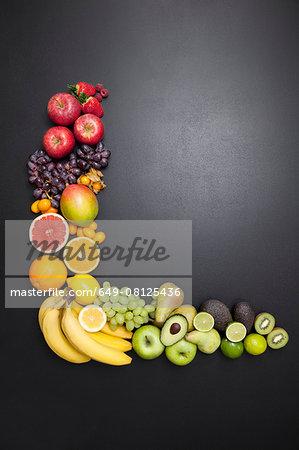 Overhead still life of variety of fresh fruit arrangement