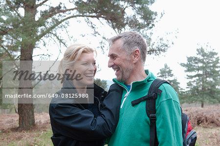 Romantic hiking couple walking in woods