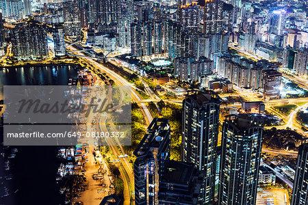 Aerial of Kowloon at night, with light trails, Hong Kong, China