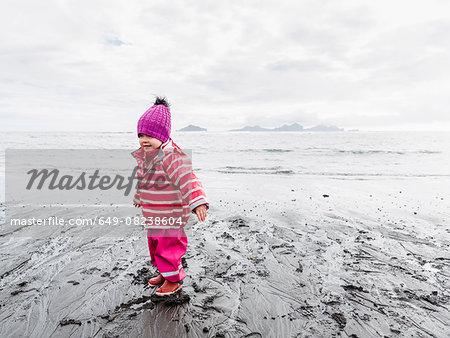 Young girl on beach, Landeyjahofn, Iceland