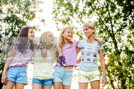 Girls chatting on field, Flanders, Belgium