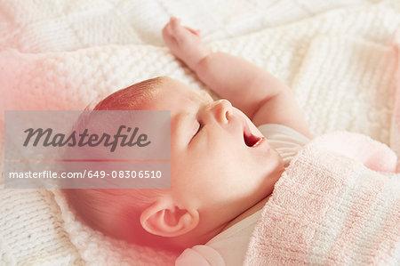 Baby yawning in sleep