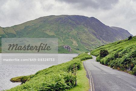 Rural lakeside road, Lake Buttermere, Cumbria, UK