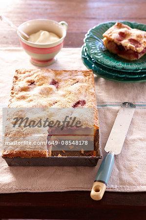 Overhead view of rustic apple pie in baking tin