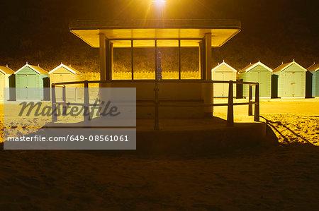 Empty kiosk on beach at night