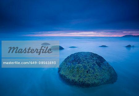 Waves washing over rocks on beach