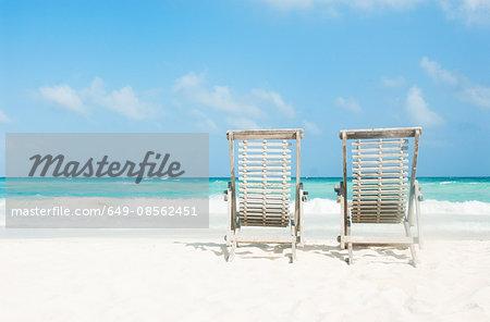 Two sun loungers on beach, Tulum, Mexico