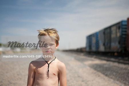 Boy by train tracks