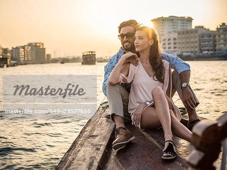 Romantic couple sitting on boat at Dubai marina, United Arab Emirates