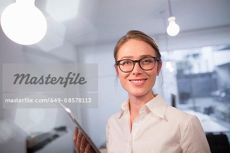 Portrait of businesswoman using digital tablet in office
