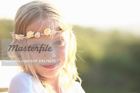 Portrait of blond girl wearing flower headband, Buonconvento, Tuscany, Italy