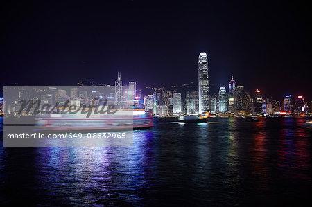 Ferry and harbor at night, Hong Kong, China