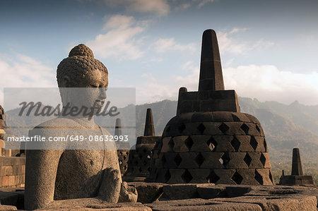 Buddha on rooftops, The Buddhist Temple of Borobudur, Java, Indonesia