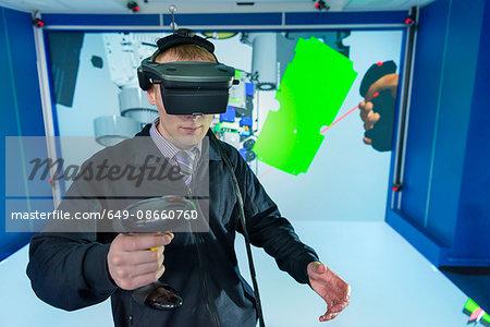 Engineer wearing VR headset in virtual reality suite