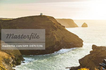 Building on top of cliff by ocean, Boscastle, Cornwall, UK
