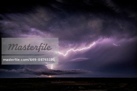 Lightning sparks from a spinning supercell thunderstorm at night near Leoti, Kansas