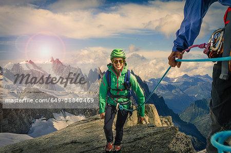 Climbing couple climbing ridge at Mont Savoie, France
