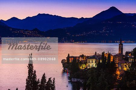 Buildings illuminated at sunset by Lake Como, Varenna, Italy