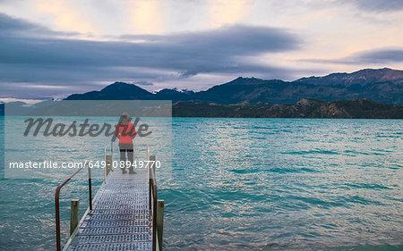 Woman standing on pier at Lago Rio Tranquillo, Carretera Austral, Aysen, Chile