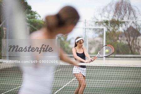 Serious girl playing tennis
