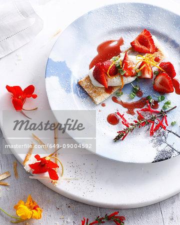 Fresh strawberry tart with cream and icing sugar