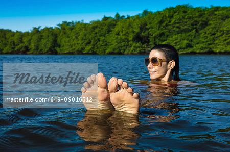 Woman in sea, Fortaleza, Ceara, Brazil, South America