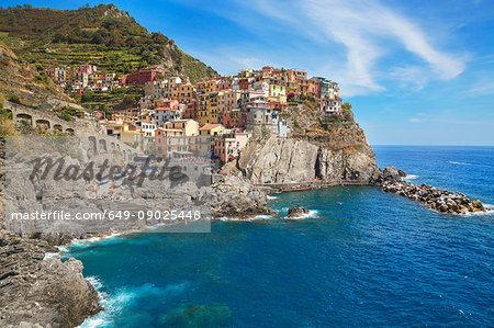 Colourful buildings on cliff side, Manarola, Liguria, Italy, Europe