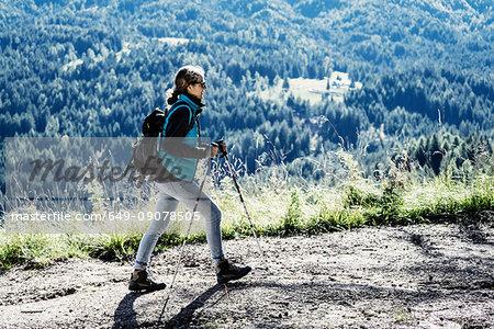 Woman hiking, Madonna di Pietralba, Trentino-Alto Adige, Italy, Europe